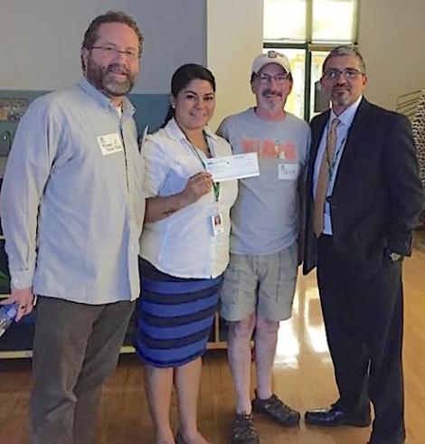 (Michael Taylor-Judd, Delridge Community Center Coordinator Angie Ramirez, Pete Spalding, and Parks Superintendent Jesus Aguirre, left to right.)